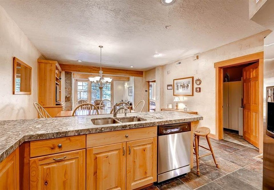 Drink Kitchen cabinet property cabinetry home hardwood countertop cuisine classique counter cottage farmhouse appliance Island