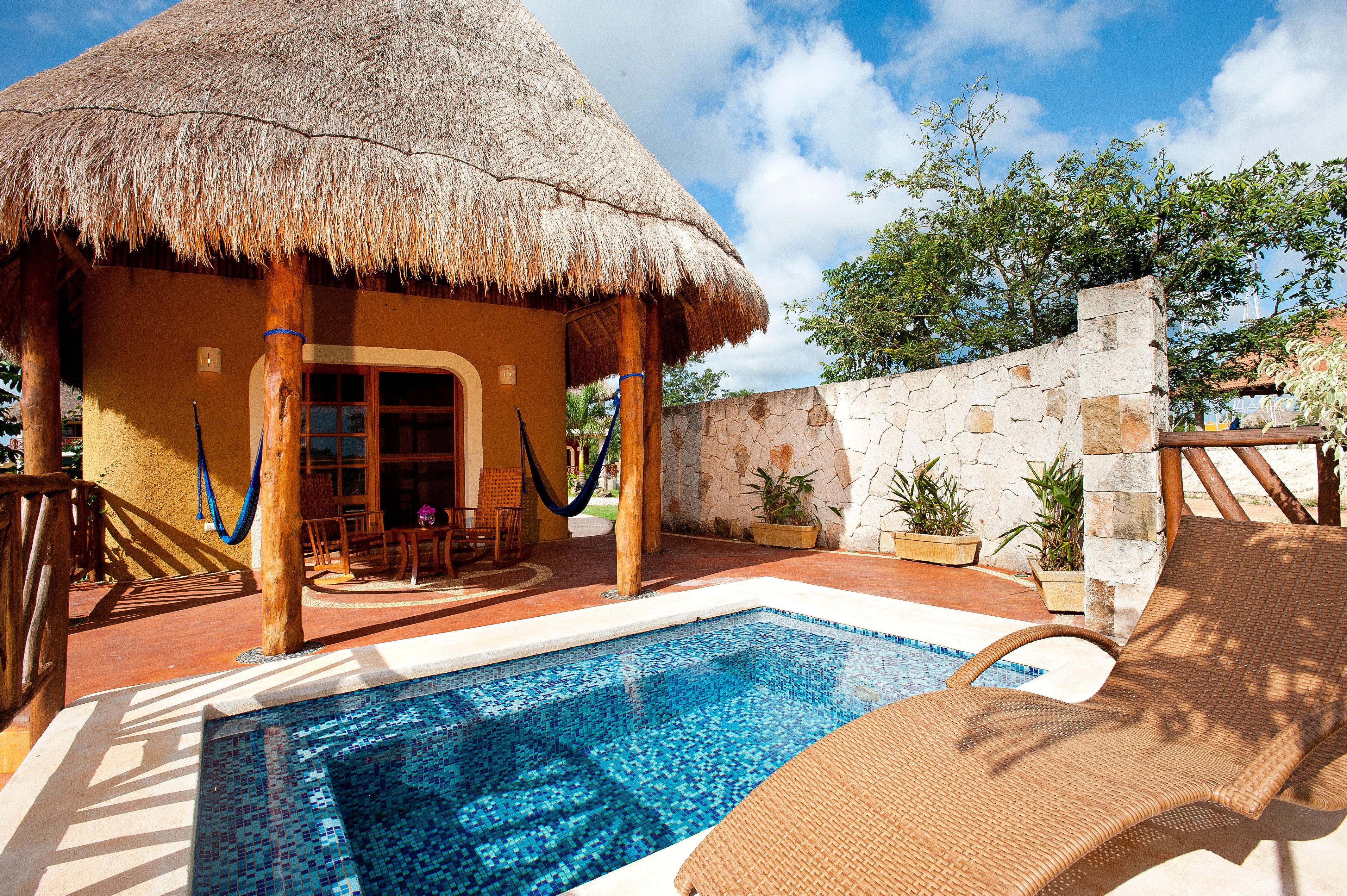 Drink Lounge Luxury Pool swimming pool property leisure building Resort Villa house home cottage backyard hacienda mansion roof