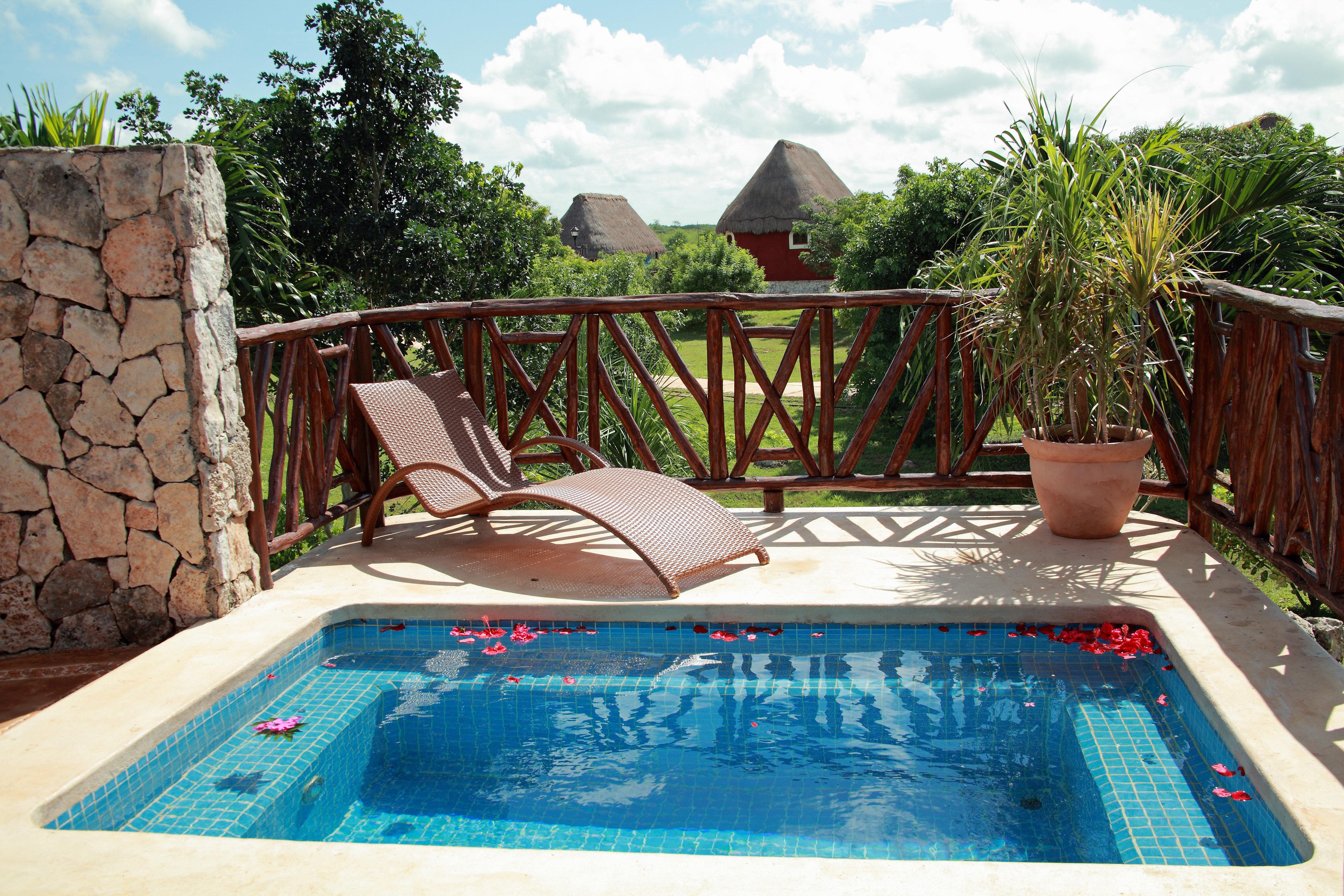 Drink Lounge Luxury Pool tree swimming pool property leisure backyard Villa Resort bathtub cottage jacuzzi