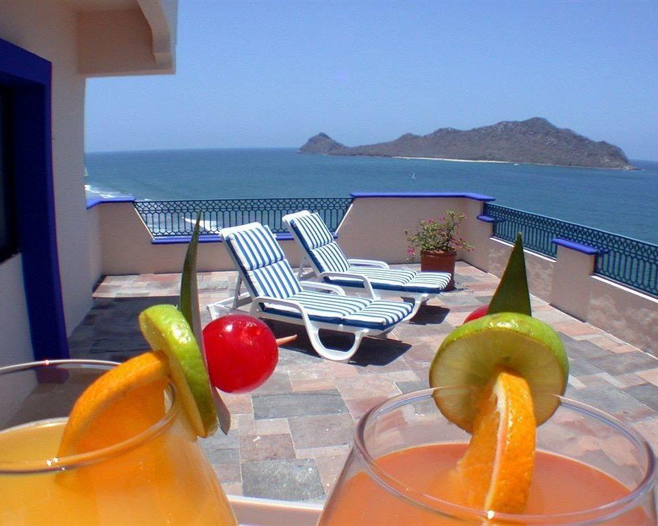 orange property food leisure swimming pool fruit drink beverage Villa Resort fruit Drink caribbean
