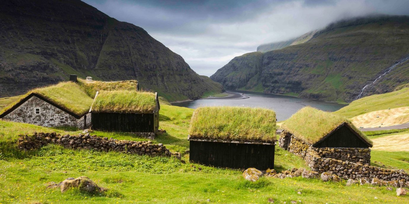 Trip Ideas grass mountain outdoor sky highland mountainous landforms field geographical feature grassy pasture mountain range green rock hill fell valley loch rural area Village hut plateau landscape lush meadow alps old agriculture fjord hillside