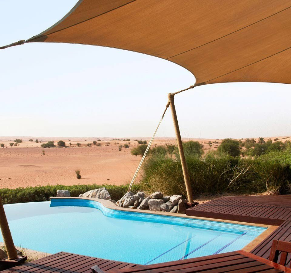 Dubai Hotels Luxury Travel Middle East property shade tent swimming pool canopy leisure outdoor structure sunlounger landscape roof outdoor furniture umbrella Resort backyard Villa