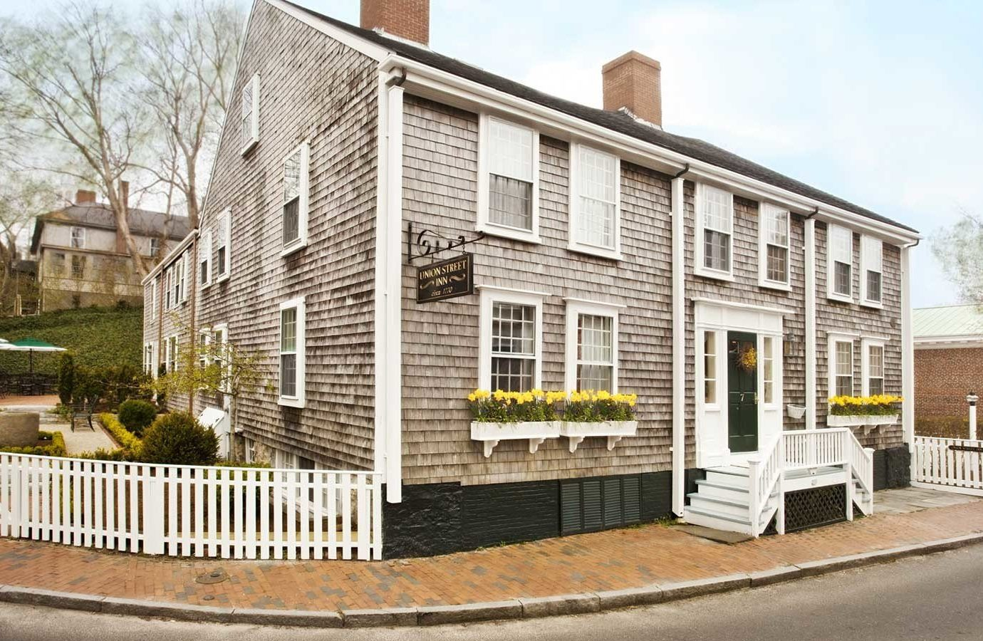 Hotels outdoor building road property house home street real estate cottage residential area neighbourhood window historic house facade siding estate stone curb