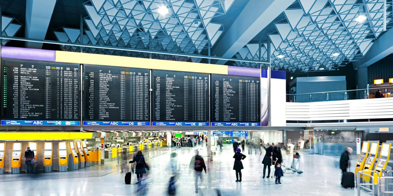 Travel Tips indoor transport airport terminal building shopping mall ceiling ice rink public transport convention center airport arena retail headquarters