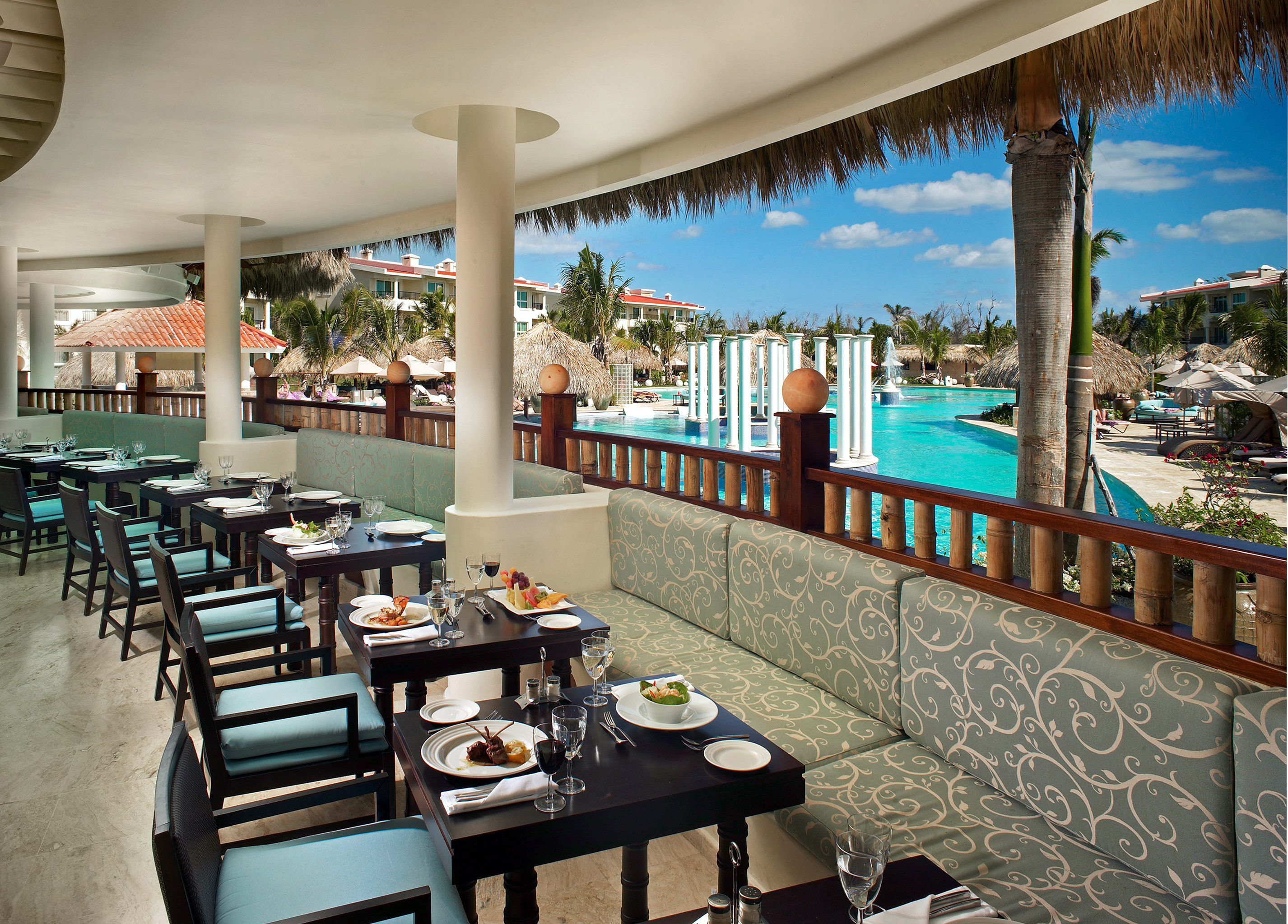 All-inclusive Balcony Dining Drink Eat Family Hotels Patio Pool Resort Terrace table chair floor leisure property indoor restaurant ceiling vacation estate condominium interior design area furniture several