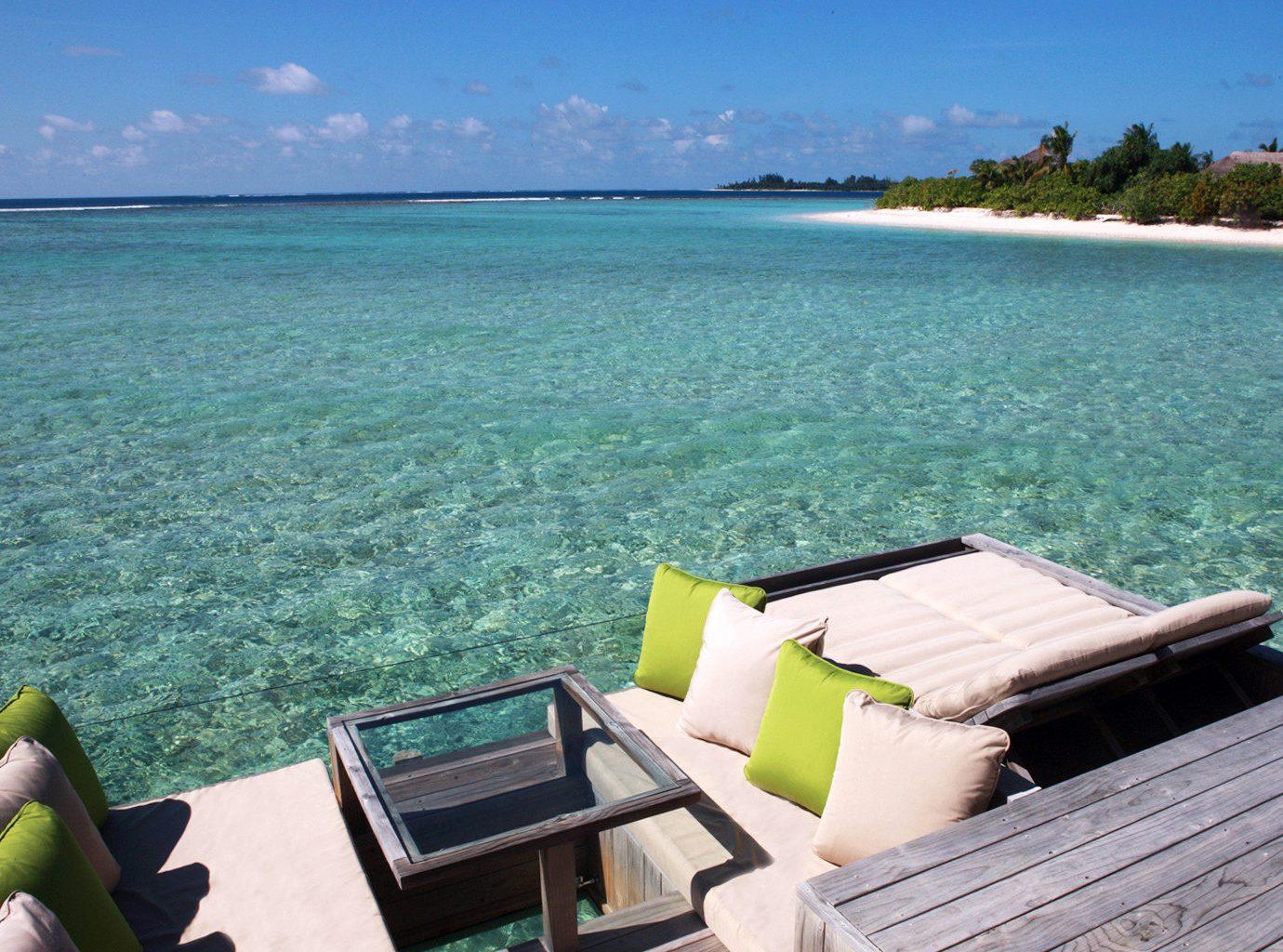 Beach Beachfront Exterior Luxury Ocean Romantic Trip Ideas sky outdoor water leisure Sea vacation shore caribbean Coast bay green swimming pool Resort estate