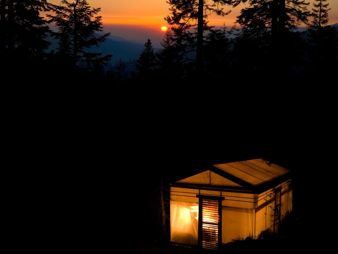 Glamping Outdoors + Adventure Trip Ideas tree outdoor sky Sunset night atmosphere light sunrise evening morning darkness dawn Sun sunlight dusk reflection dark setting clouds
