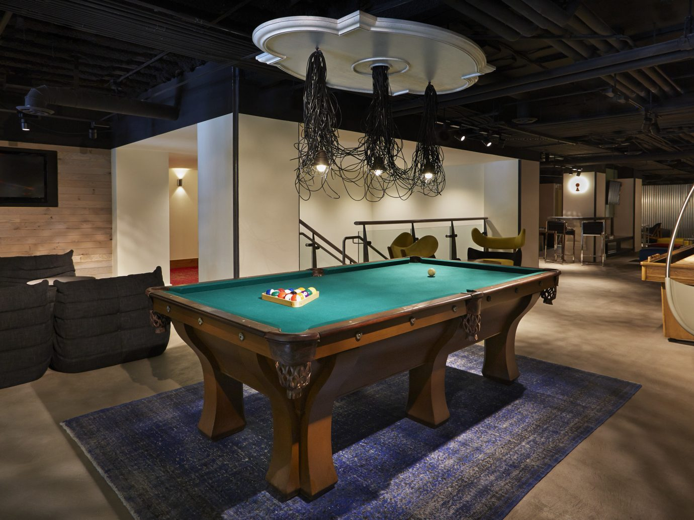 Hotels indoor floor billiard room recreation room room ceiling cue sports table Pool games estate billiard table interior design recreation indoor games and sports screenshot Design furniture