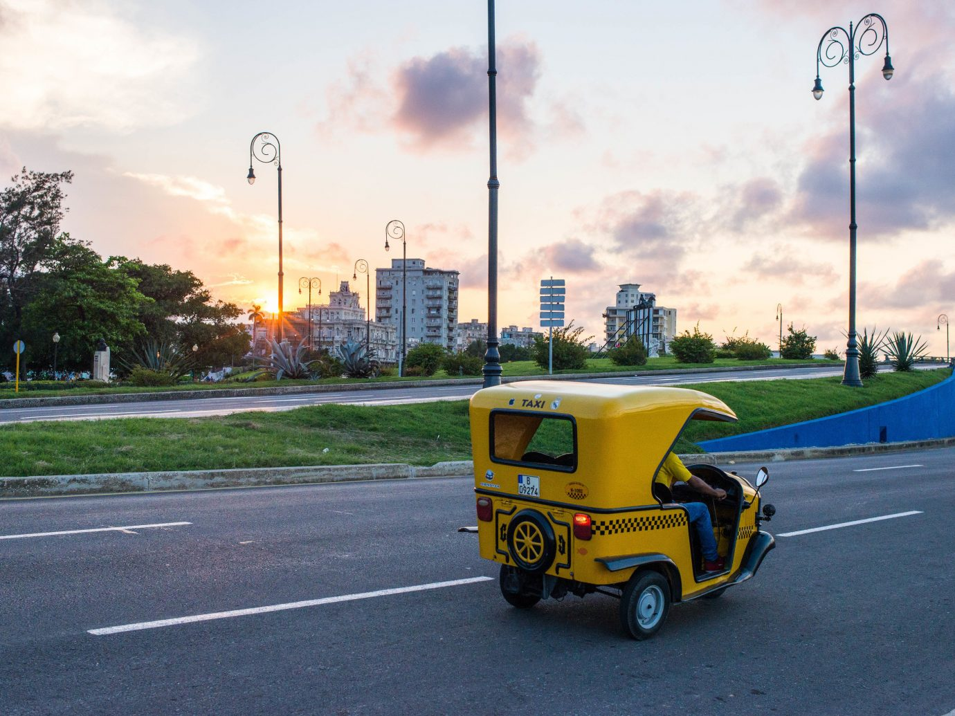 Travel Tips sky road outdoor yellow car transport street vehicle infrastructure driving traffic scooter highway