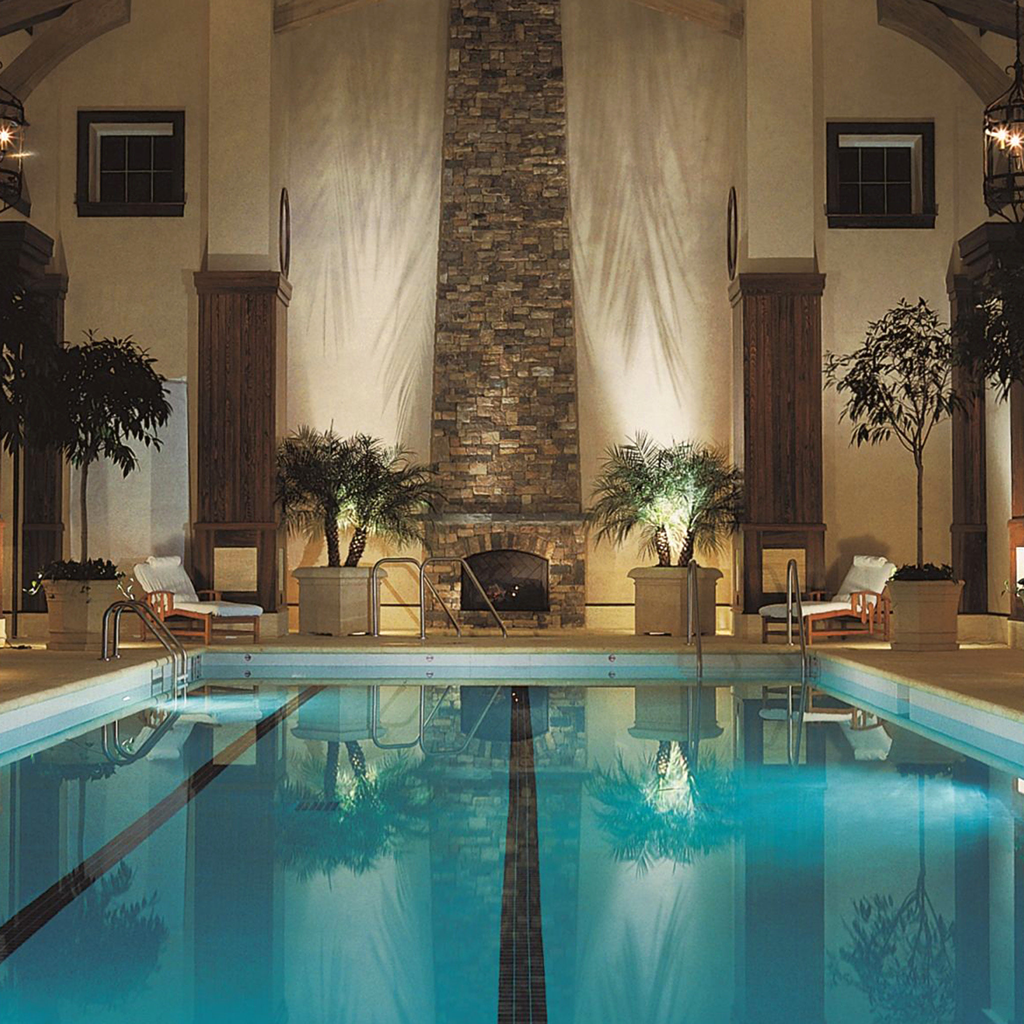 Hotels Lakes + Rivers Lounge Luxury Modern Pool Romance Trip Ideas swimming pool indoor property estate mansion interior design Villa Resort altar