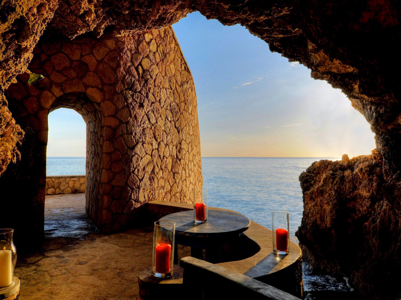 Dining Drink Eat Hotels Luxury Romance Romantic Scenic views Trip Ideas Tropical Waterfront water outdoor building mountain arch Sea evening overlooking formation