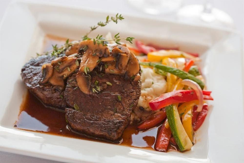 Eat food plate meat steak cuisine roast beef vegetable beef tenderloin beef square containing piece de resistance