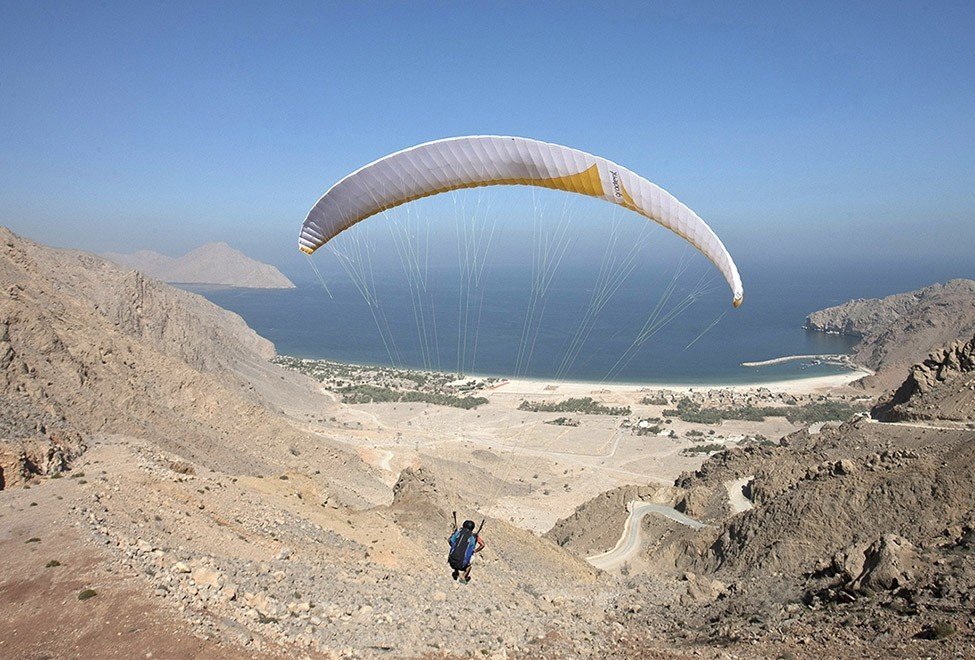 Hotels sky outdoor paragliding ground air sports sports windsports Nature mountain extreme sport Adventure gliding parachuting day