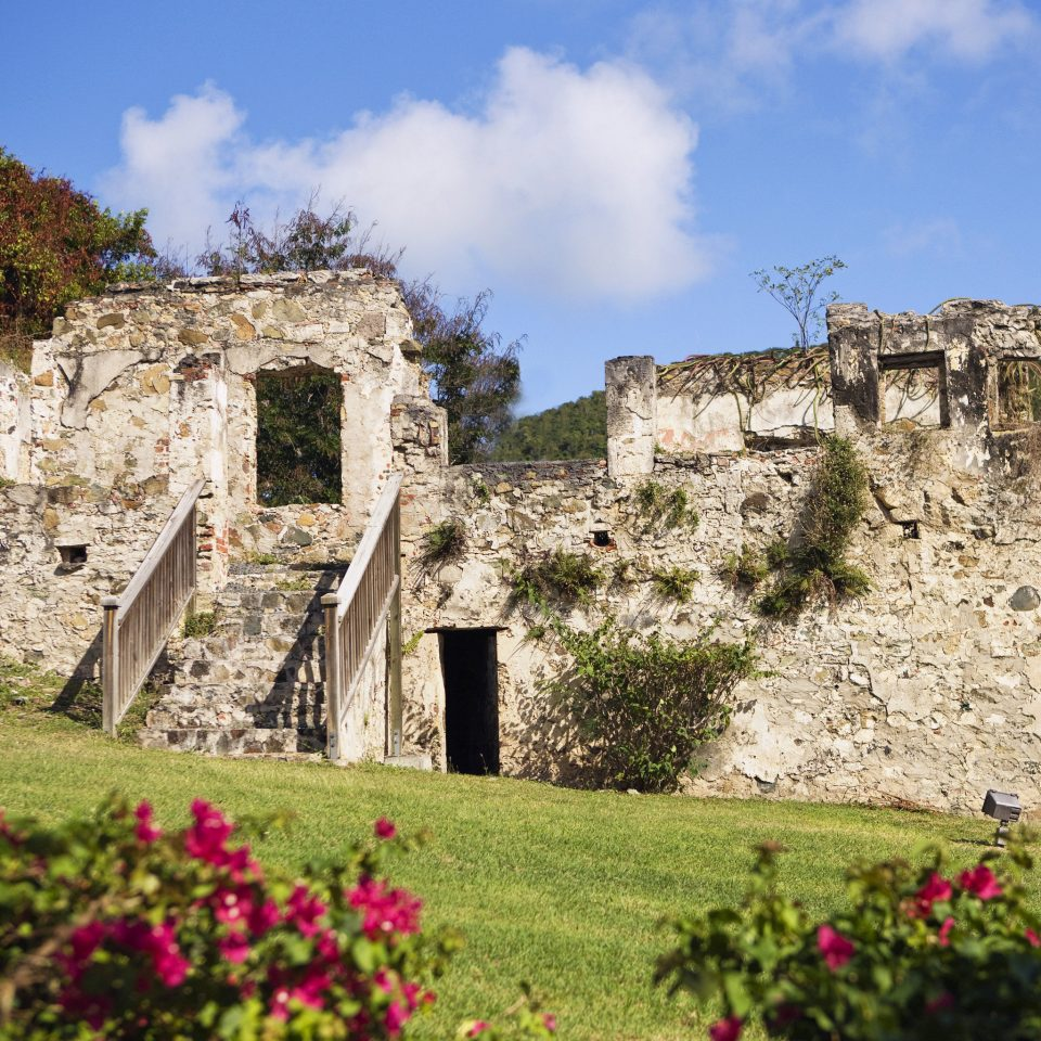 Eco Family Hotels Landmarks Luxury Resort Romance Romantic Tropical grass sky flower building Ruins stone field rock historic site archaeological site castle fortification ancient history brick Village rural area monastery château abbey old ruin structure Garden
