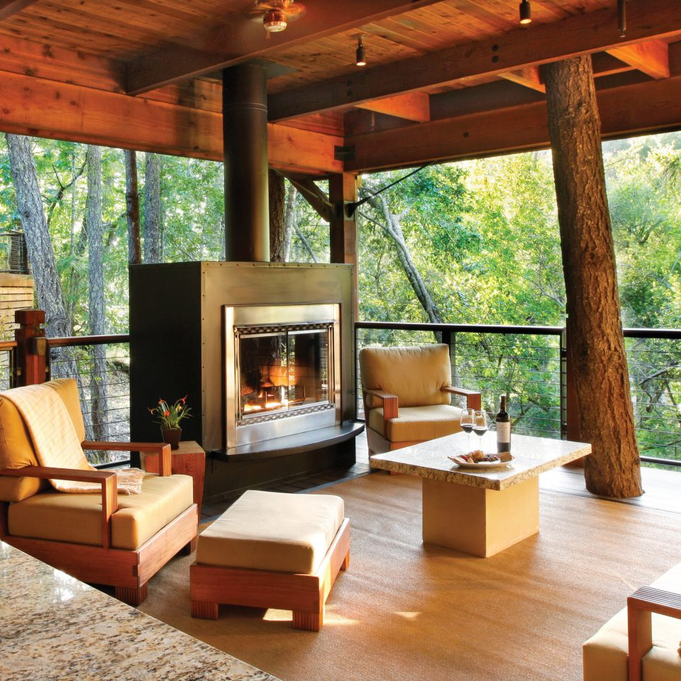Eco Fireplace Food + Drink Hotels Luxury Outdoors Ranch Romance Romantic Rustic Scenic views Trip Ideas Wellness property Resort wooden living room home Villa cottage hacienda eco hotel outdoor structure farmhouse porch log cabin