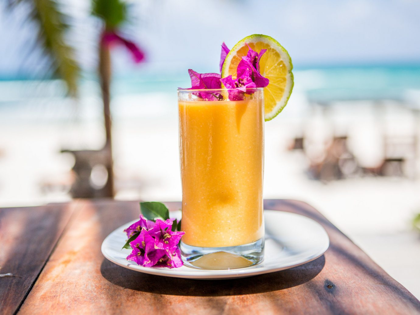 Trip Ideas table cup Drink food cocktail alcoholic beverage produce mai tai juice distilled beverage brunch smoothie flavor fruit beverage close