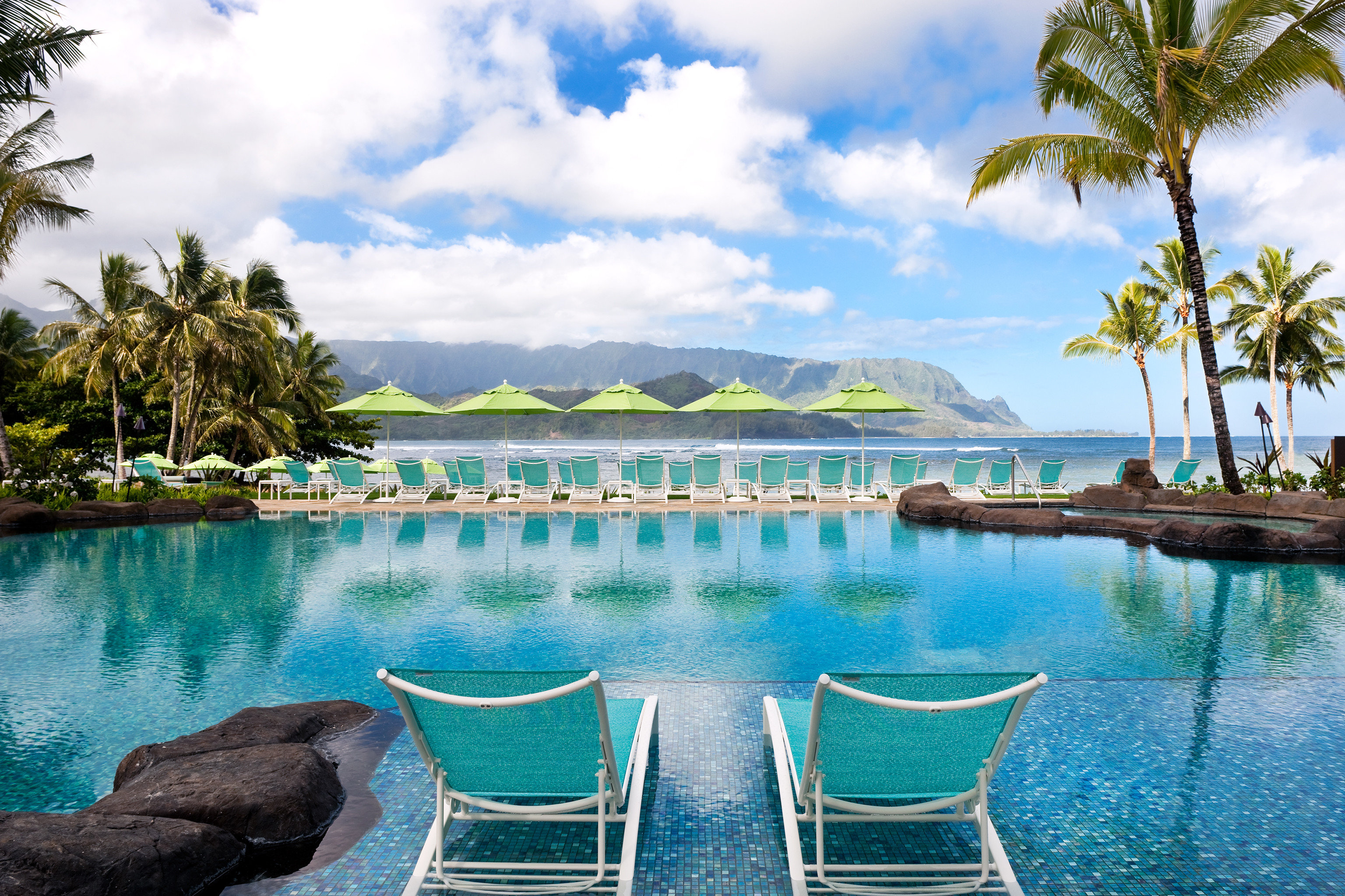 Beach Beachfront Hotels Lounge Luxury Modern Pool Trip Ideas water sky outdoor tree Boat Lake swimming pool leisure River Resort vacation caribbean estate Nature Lagoon bay Sea shore empty lined swimming surrounded