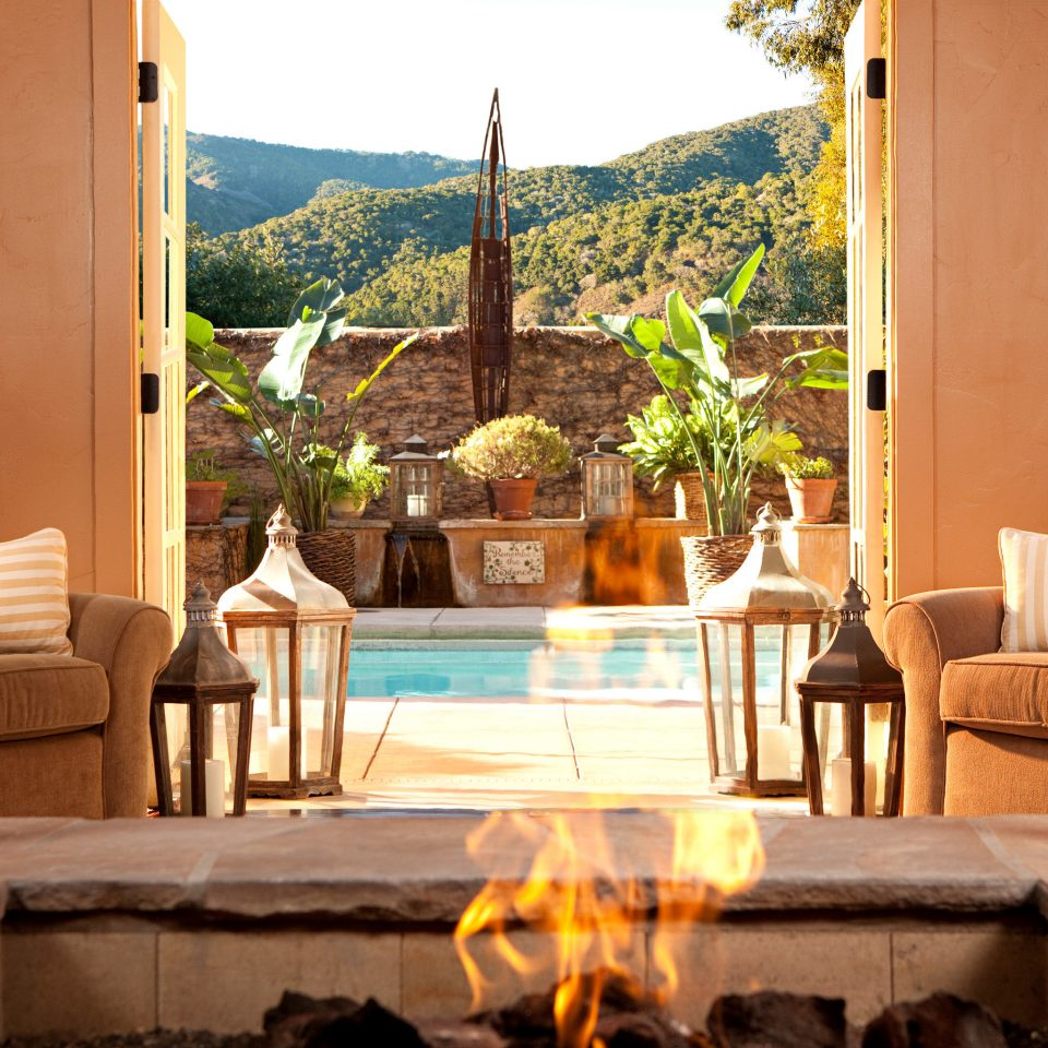 Elegant Firepit Lounge Nature Patio Pool Scenic views home house mountain lighting backyard living room Villa cottage outdoor structure overlooking