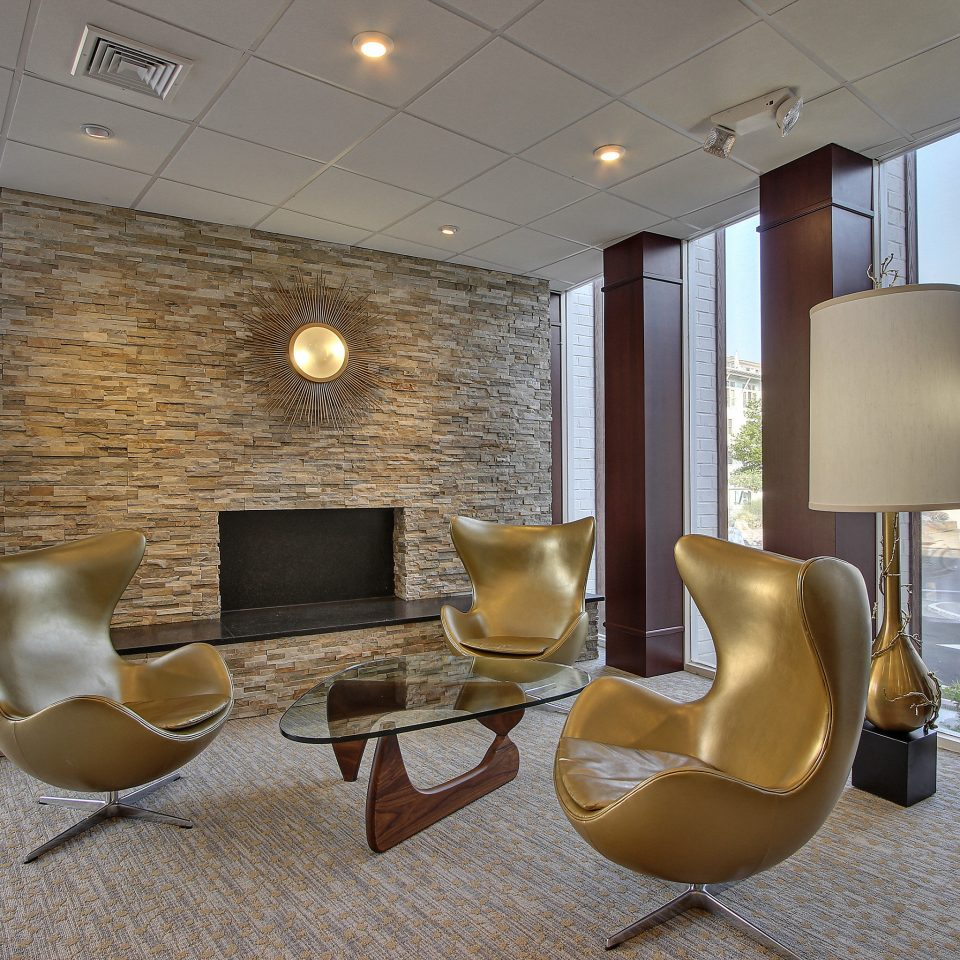 Elegant Fireplace Lounge Modern Lobby property living room condominium home Suite waiting room