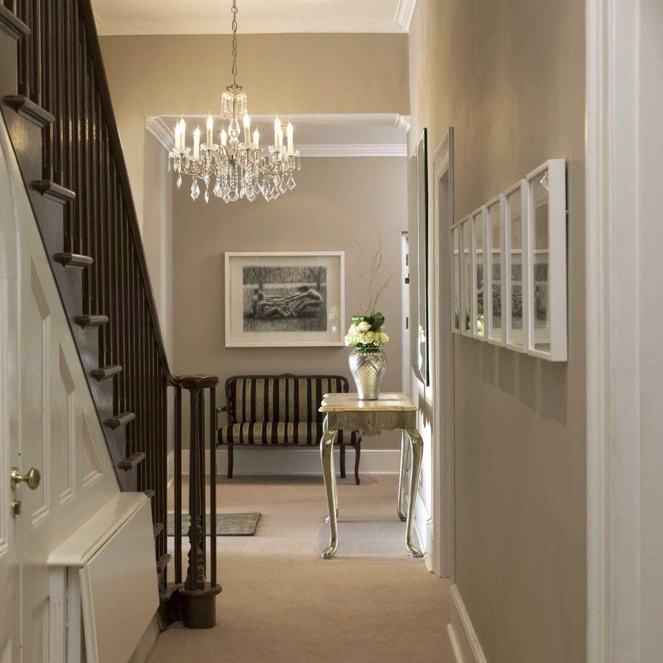 Elegant Hip Lounge Luxury property home hall hardwood cabinetry flooring Kitchen cottage wood flooring stairs