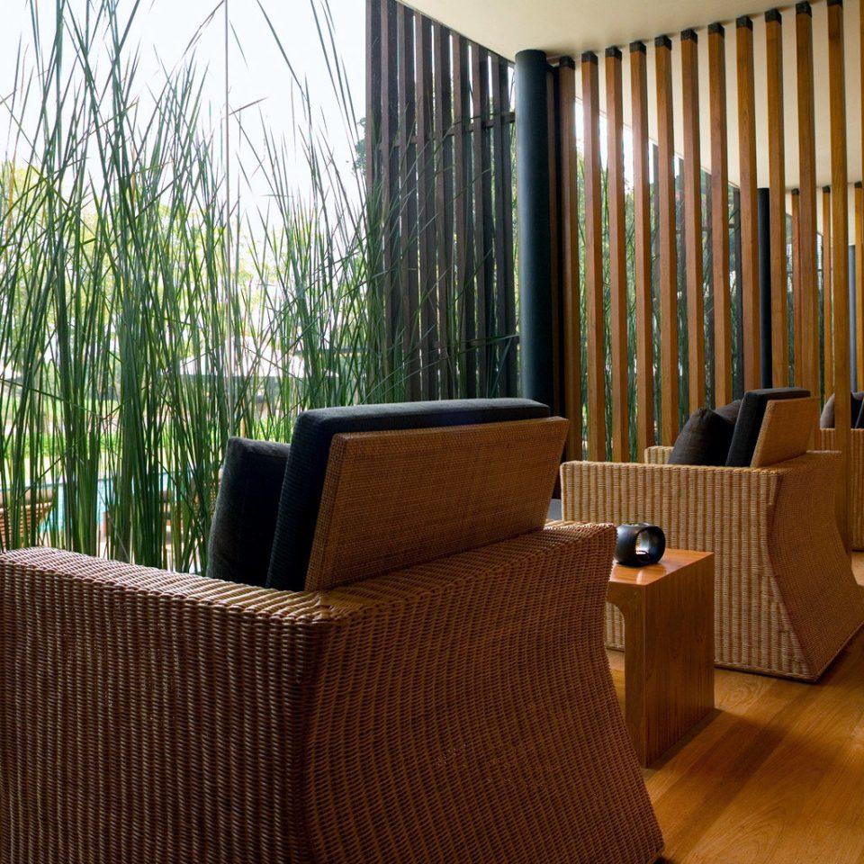 Elegant Hip Lounge Luxury Modern chair property Lobby hardwood curtain home condominium living room wood flooring