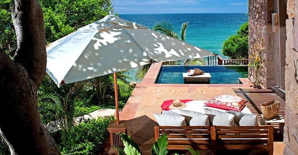 Elegant Lounge Luxury Pool Resort tree chair wooden hut Village Jungle cottage travel caribbean
