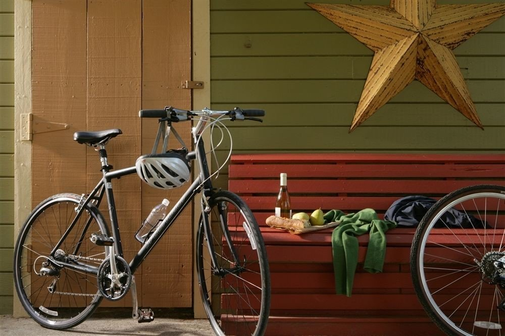 Elegant Lounge Luxury bicycle building vehicle parked land vehicle road bicycle hybrid bicycle basket racing bicycle cyclo cross bicycle sidewalk wheel transport sports equipment leaning rack