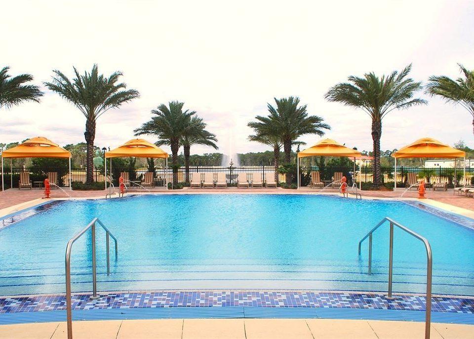 Elegant Lounge Luxury Modern Pool sky water swimming pool property Resort leisure palm Villa condominium resort town caribbean empty blue swimming lined shore