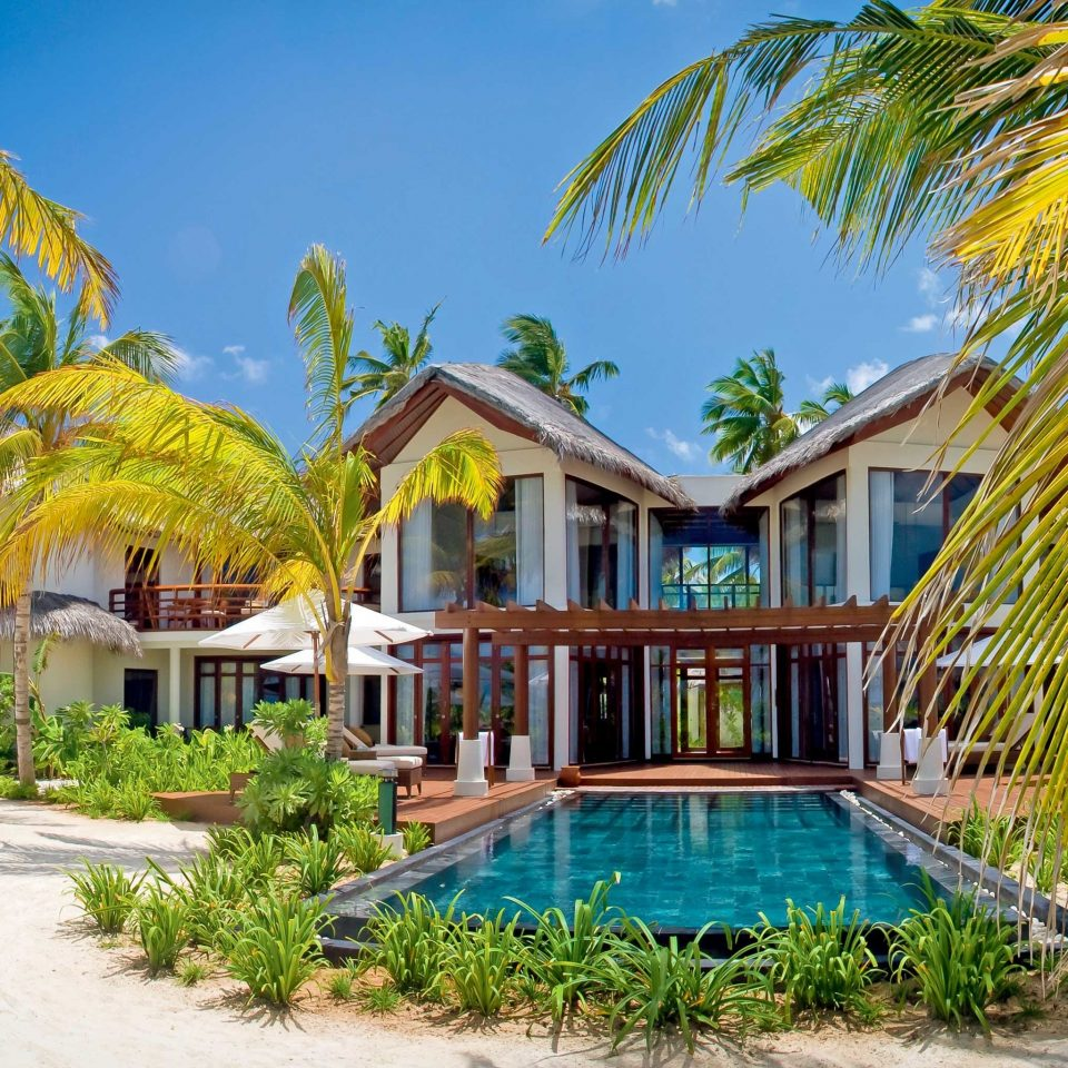 Elegant Lounge Luxury Modern Pool tree palm Resort plant property leisure caribbean house arecales swimming pool Villa hacienda eco hotel palace Village