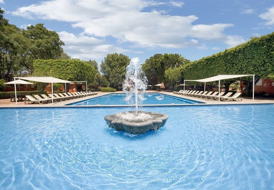 Elegant Lounge Luxury Pool tree sky water swimming pool leisure property Resort reflecting pool reef resort town Villa Water park blue swimming surrounded