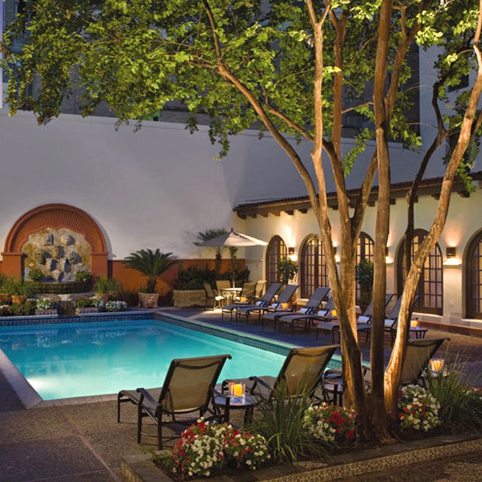 Elegant Lounge Patio Pool Terrace tree property Resort swimming pool hacienda Villa mansion home backyard