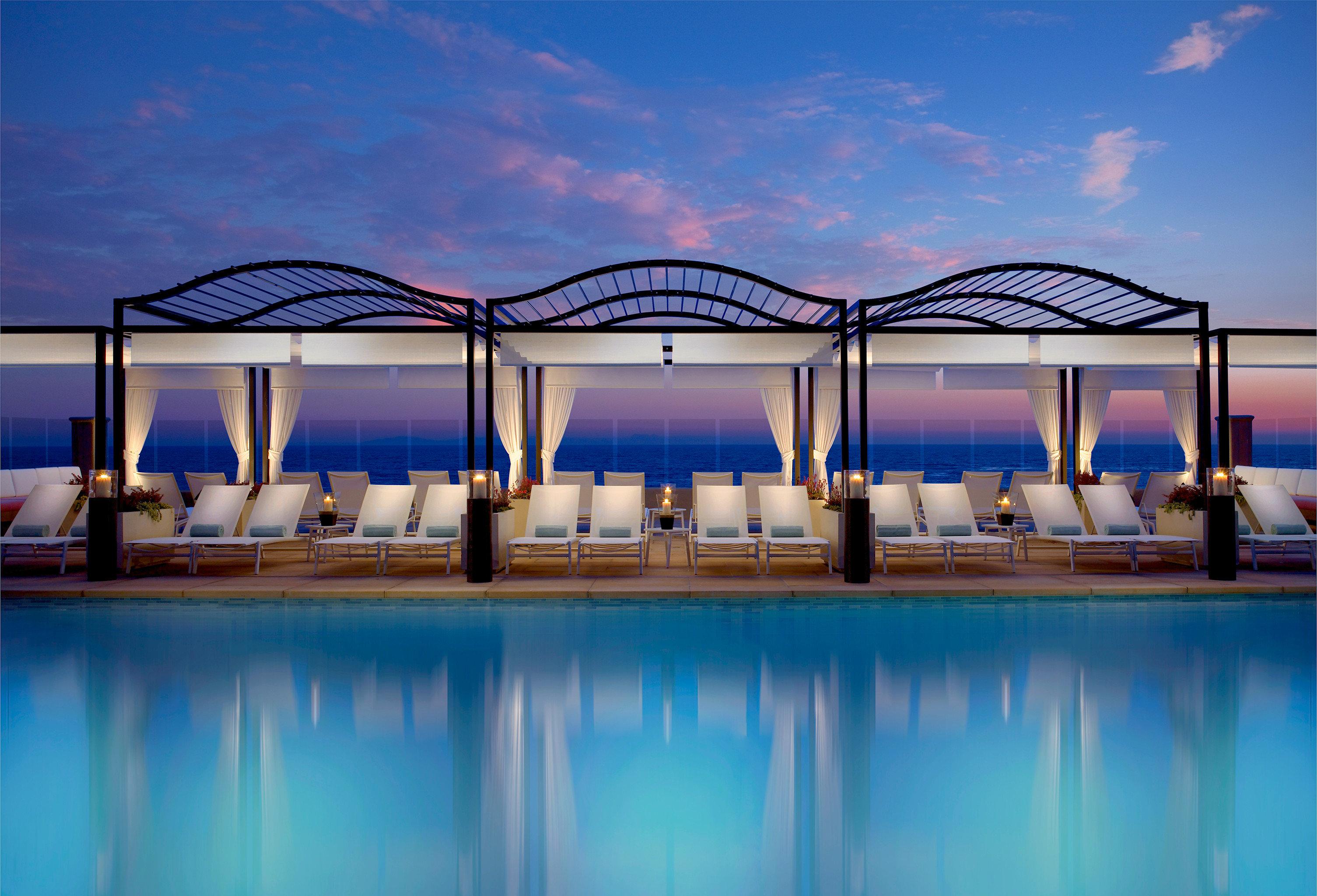 Elegant Modern sky water leisure swimming pool blue scene Resort marina dock evening colorful colored