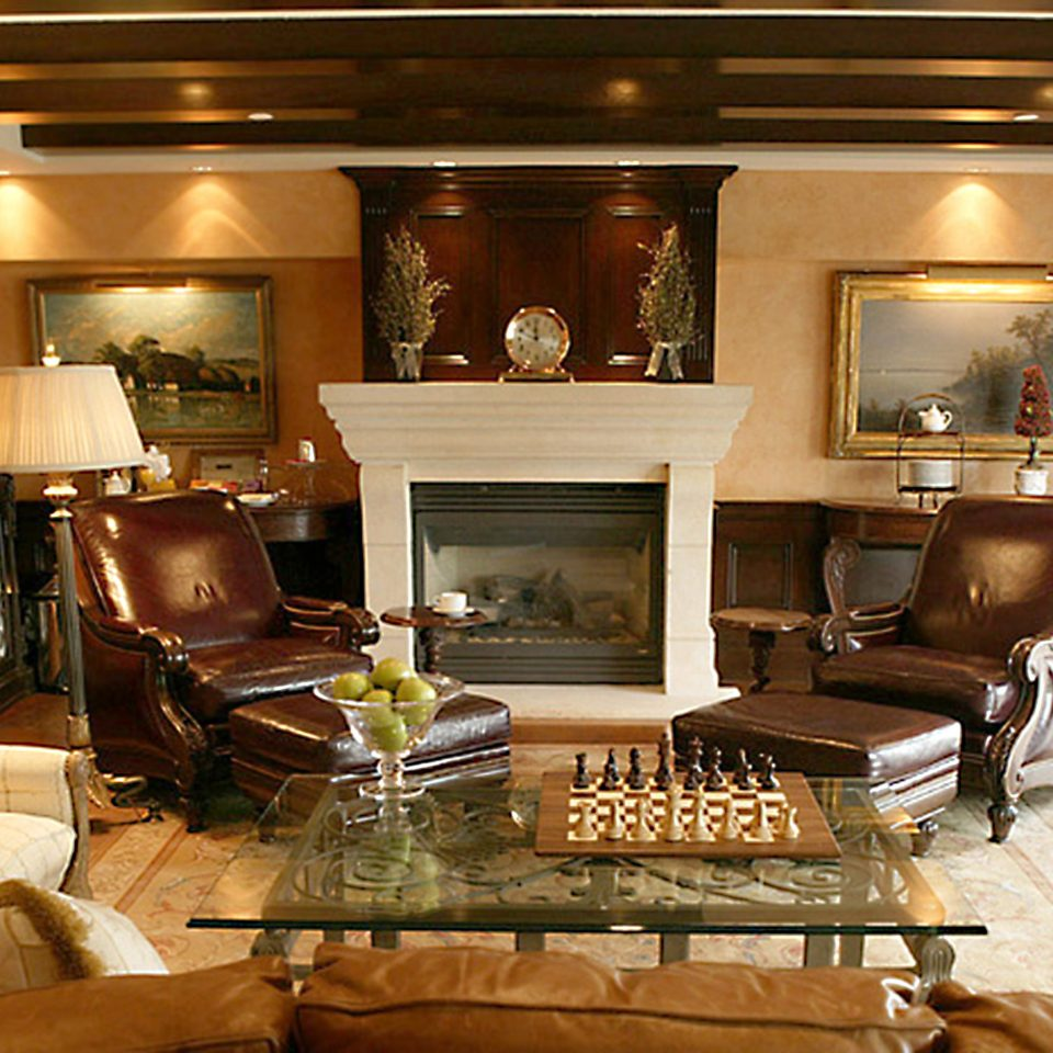 Entertainment Fireplace Play sofa living room property home Suite recreation room mansion