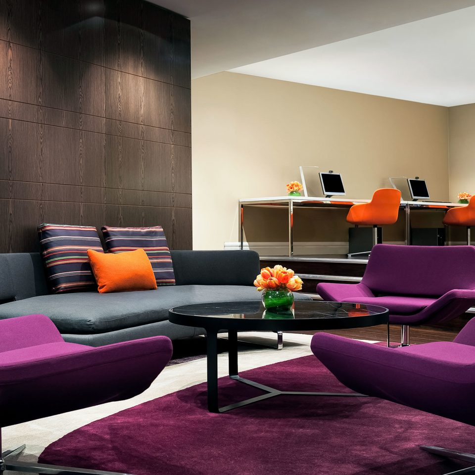 Entertainment Lounge Resort color living room purple pink property red couch home Lobby waiting room condominium leather sofa set