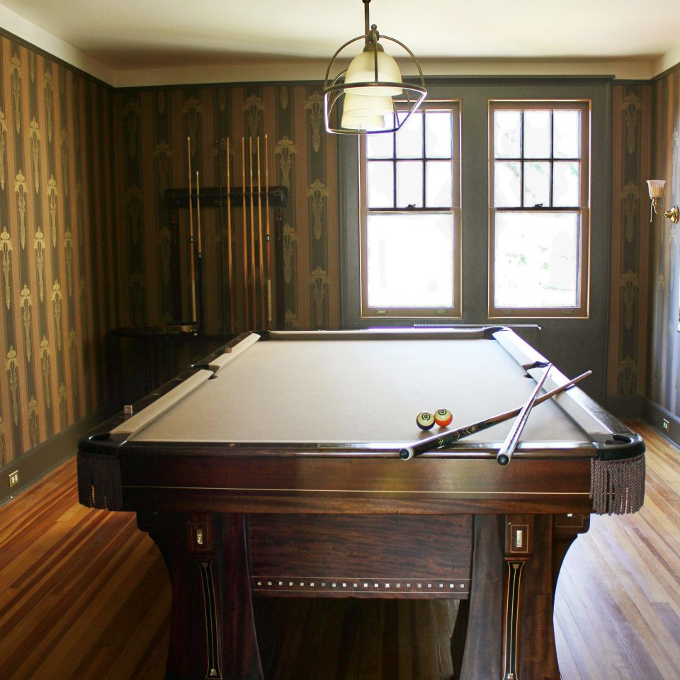 Entertainment Lodge Play billiard room property wooden recreation room hardwood countertop home cabinetry wood flooring hard worktable