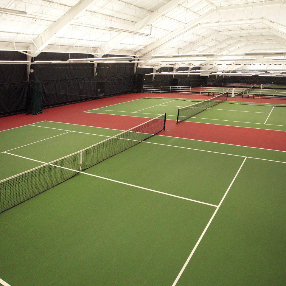 Entertainment Sport court structure sport venue sports athletic game tennis court green soccer specific stadium net racquet sport tennis