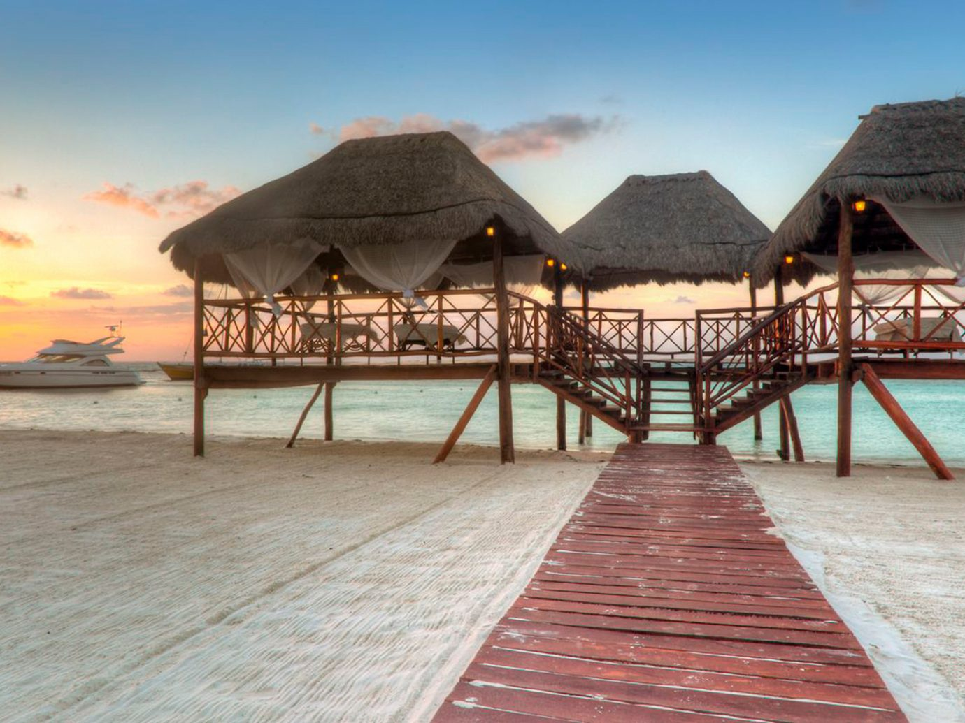 Beachfront Hotels Overwater Bungalow Romance Romantic Waterfront ground sky outdoor water Beach pier walkway vacation Resort boardwalk Sea empty lined sandy several