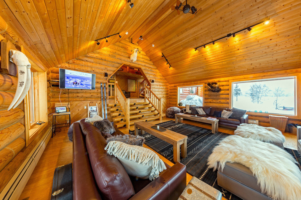 Hotels Lakes + Rivers Romance indoor ceiling floor room log cabin estate home living room interior design cottage real estate vehicle furniture