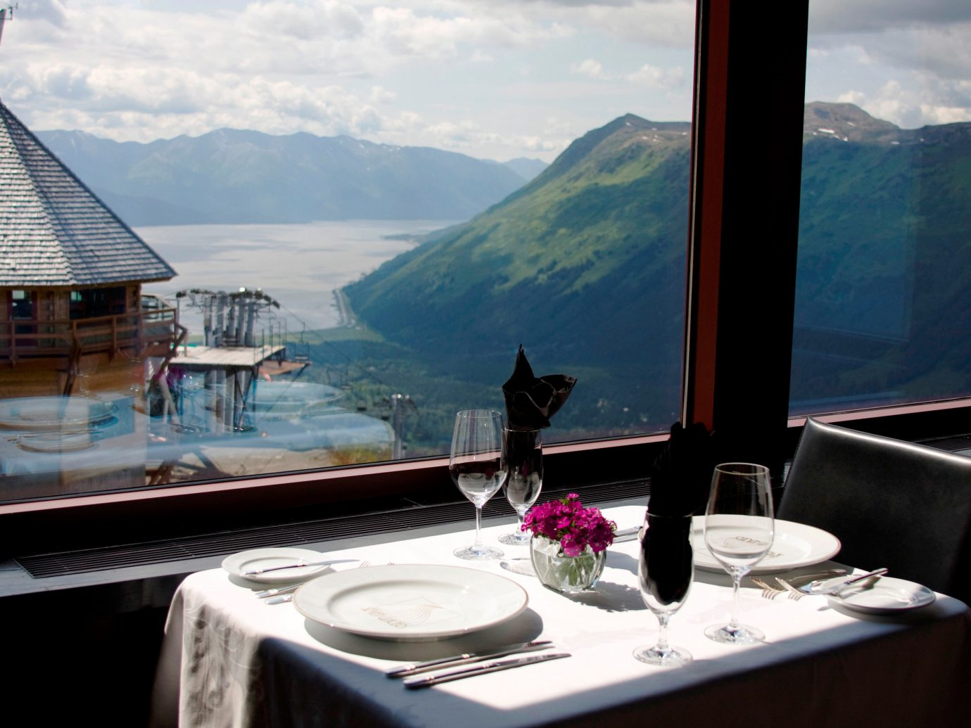 Bar Dining Drink Eat Hotels Lakes + Rivers Mountains Scenic views Trip Ideas Waterfront mountain sky room house vacation passenger ship yacht Boat estate swimming pool home restaurant interior design vehicle luxury yacht overlooking