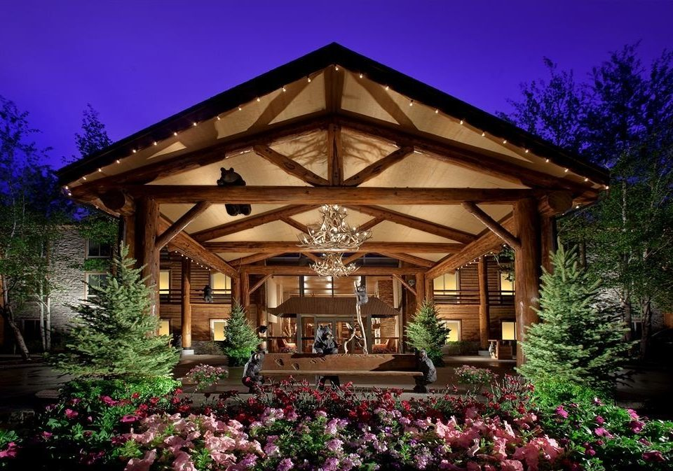 Exterior Family Lodge tree flower building house Garden home landscape lighting outdoor structure gazebo plant mansion backyard cottage Resort purple bushes surrounded
