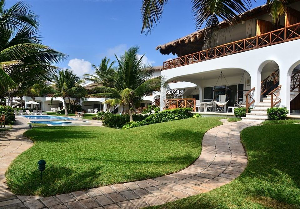Exterior Family Pool Tropical Villa grass tree sky leisure property Resort building house sidewalk walkway arecales home swimming pool residential area mansion lawn condominium hacienda Garden plant curb