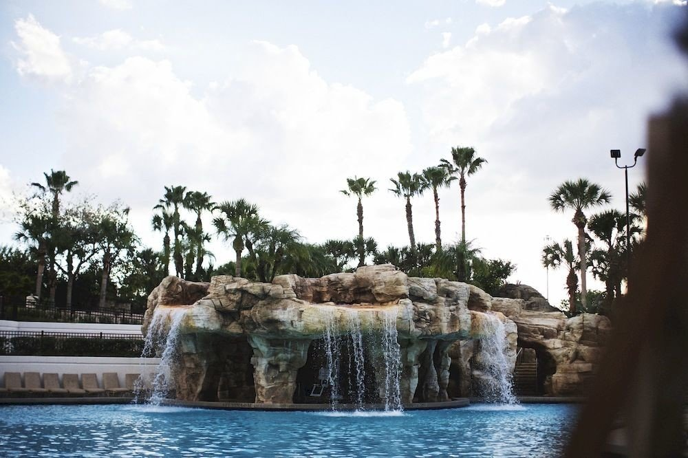 Exterior Family Grounds Pool sky water Nature tree arecales water feature Waterfall Resort swimming pool stone