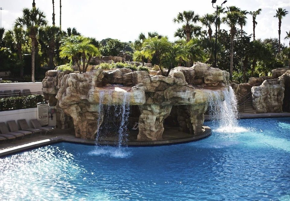 Exterior Family Grounds Pool tree sky swimming pool fountain water feature reflecting pool Resort stone