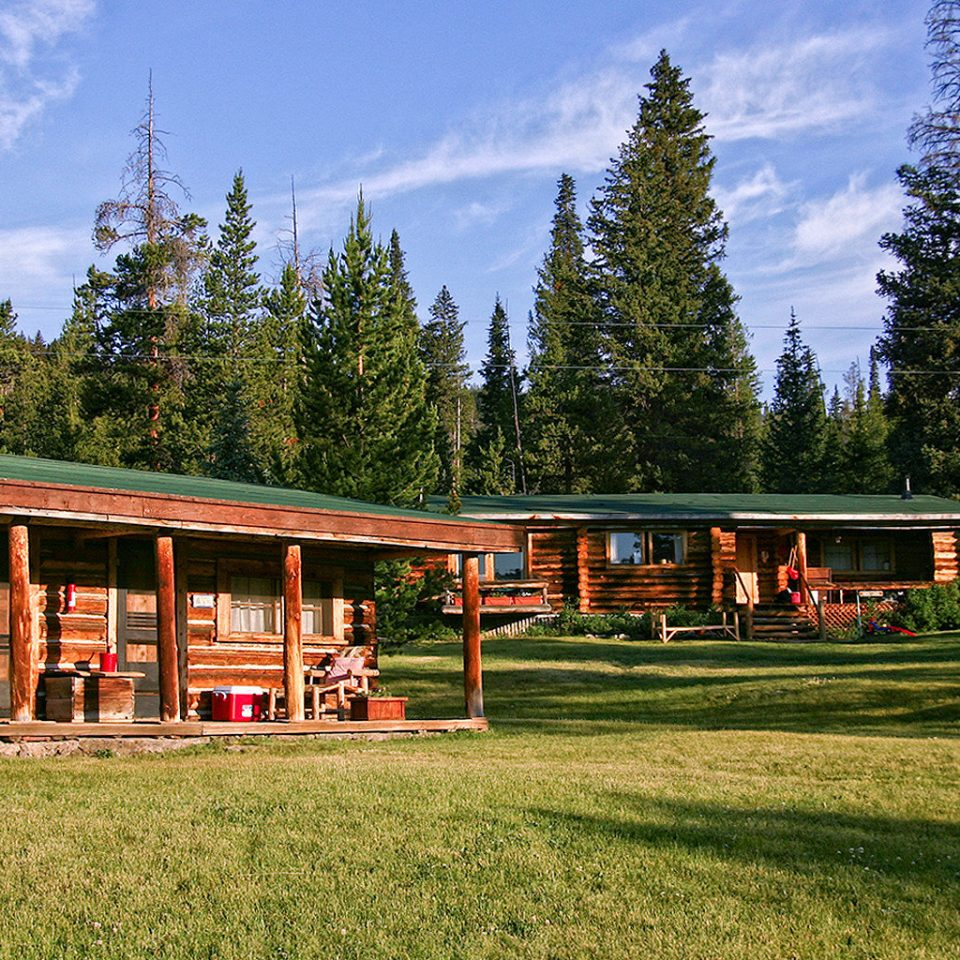 Exterior Family Lodge Nature Outdoors Ranch Rustic tree grass sky house log cabin home residential area rural area cottage lush