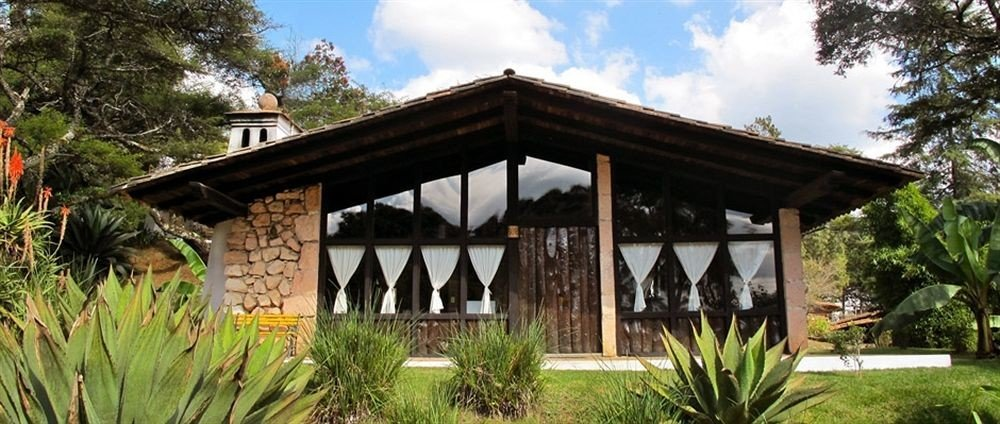 Exterior Family Resort tree sky grass building property home cottage outdoor structure shrine Villa hacienda stone