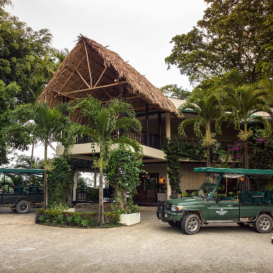 Exterior Grounds Lodge tree road rural area Village vehicle Garden restaurant Jungle flower
