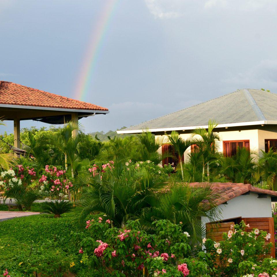Exterior Grounds Outdoors sky grass Resort Nature flower caribbean Garden rainbow