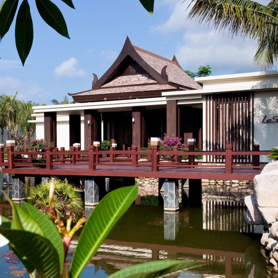Exterior Patio Resort Waterfront tree house home wooden arecales flower plant Villa mansion Garden Jungle stone