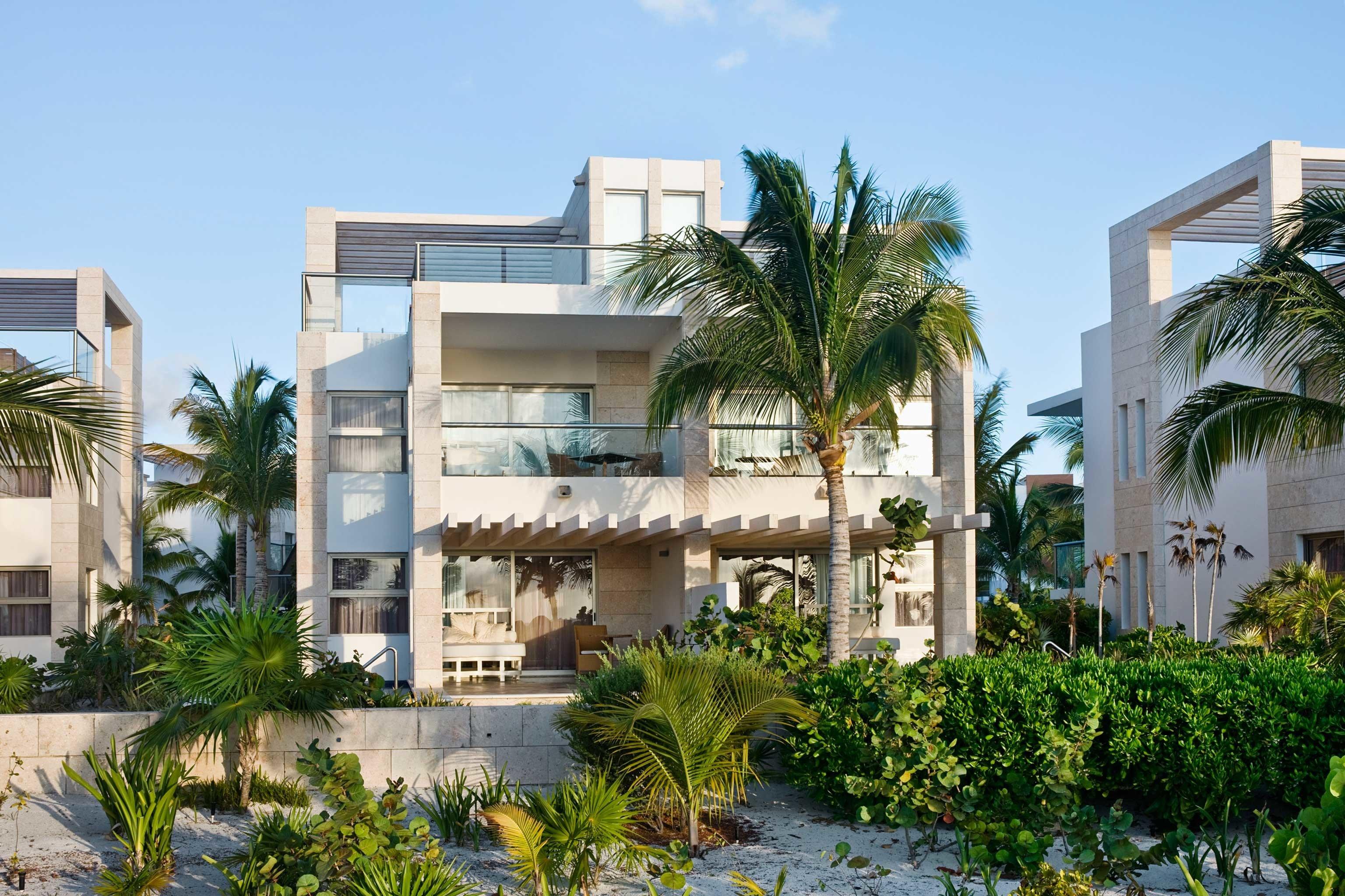 Exterior Luxury Modern Tropical building condominium property plant house Resort residential area home neighbourhood flower Garden Villa mansion bushes