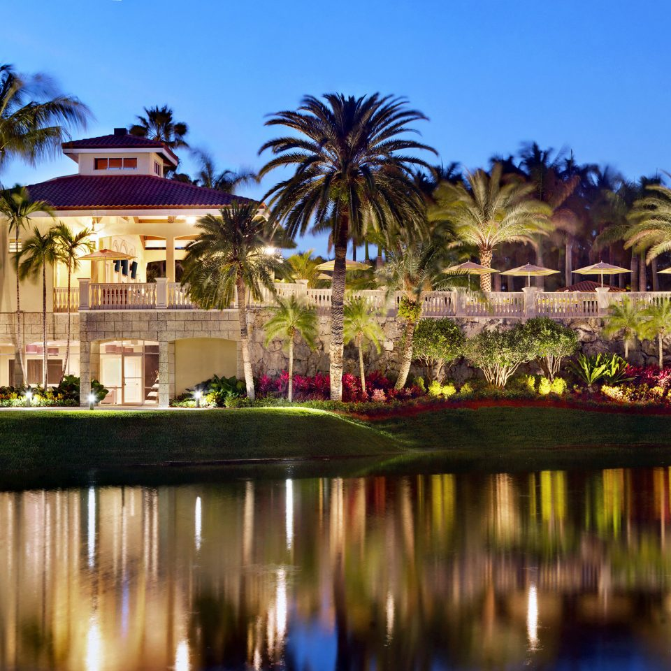 Exterior Golf Grounds Outdoor Activities Outdoors Resort Spa Sport Waterfront sky water tree palm River Nature pond palace Lake lined